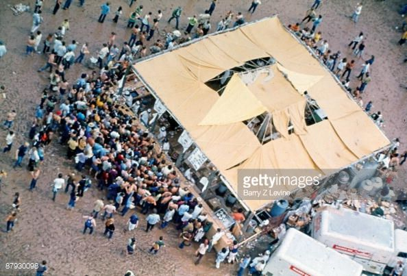 Aerial view of a food tent crowded with concert-goers at the Woodstock Music and Arts Fair in Bethel, New York, August 15 - 17 (and part of the 18th), 1969. Description from gettyimages.com. I searched for this on bing.com/images