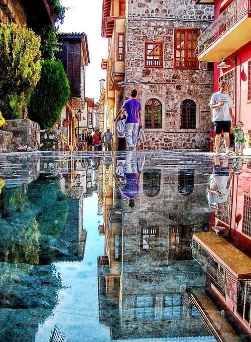 I love the full spectrum of color in this photo - and the reflection isn't water - it's stone - in Istanbul, Turkey!