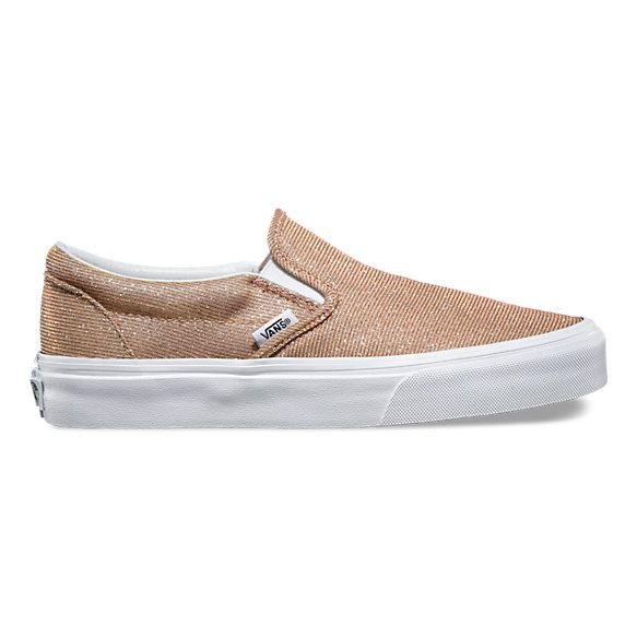 The Glitter Textile Classic Slip-On features a low profile slip-on silhouette with textured glitter textile uppers, padded collars, elastic side accents, and signature waffle outsoles.
