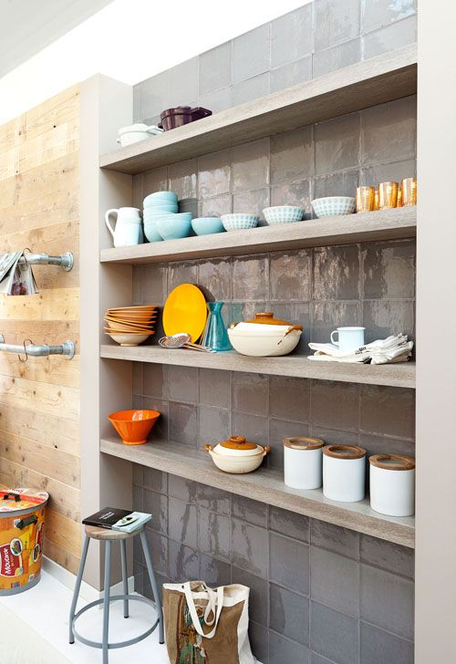 Like the idea of a tiled area behind shelves. Could add tiles to existing bookshelf