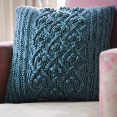 Cable knit pillow cover using cashmere yarn.