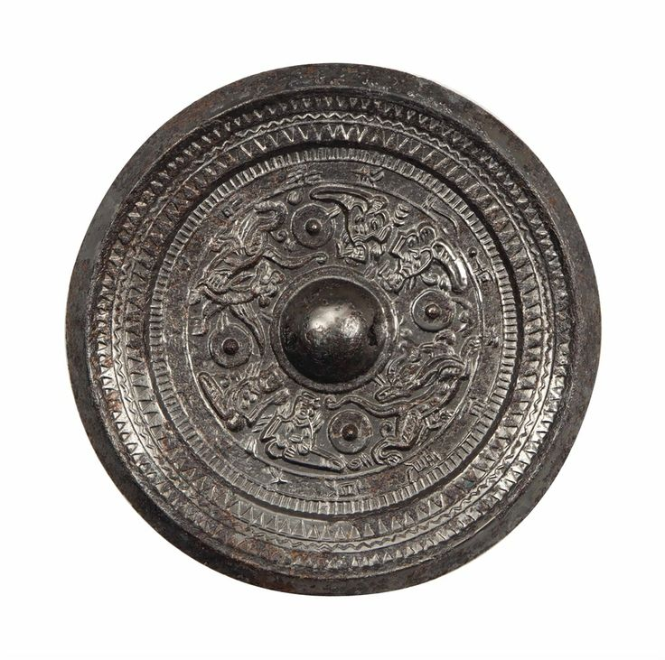 A CHINESE SILVERY BRONZE CIRCULAR MIRROR, HAN DYNASTY (206 BC-AD 220)