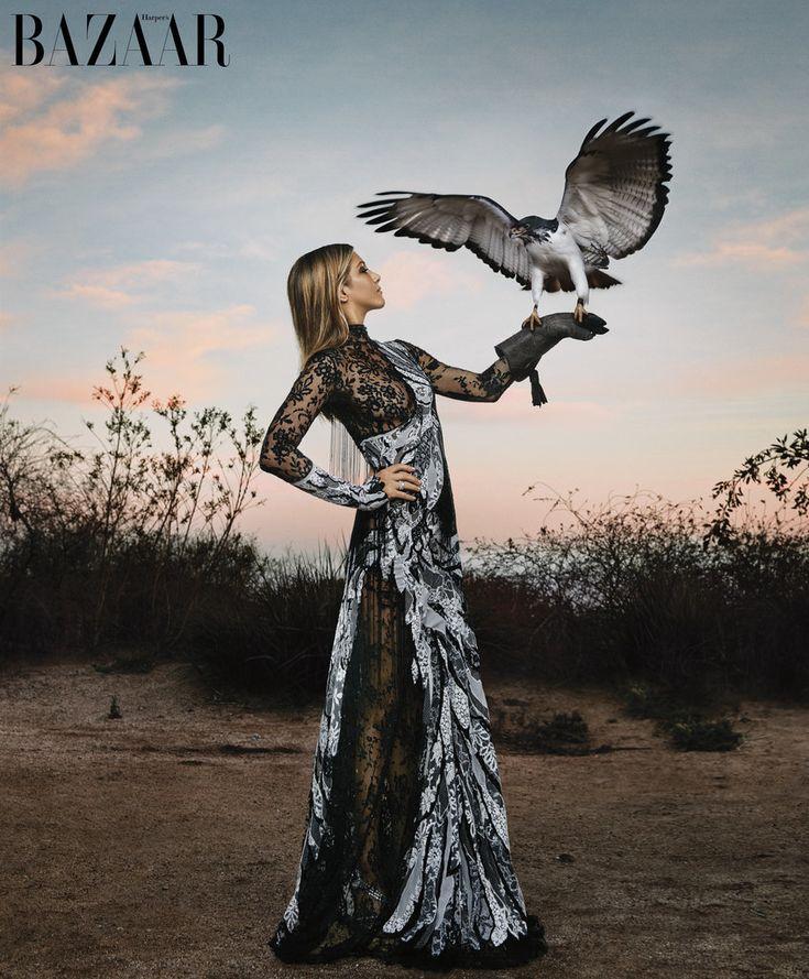 Jennifer Aniston in Harper's Bazaar, wearing an Alexander McQueen gown and Tiffany & Co. rings.