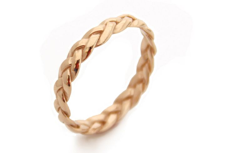 We think this braided styled ring from MayaMor is perfect for pairing with a boho wedding dress. It's handmade from yellow gold, but you can also buy it in rose and white gold too.