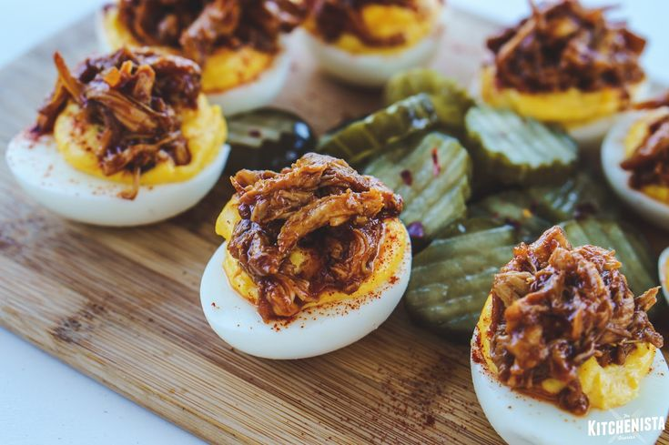 Tangy overstuffed deviled eggs topped with bbq chicken or pulled pork, for the perfect cookout appetizer! ::mix in chopped spicy pickles