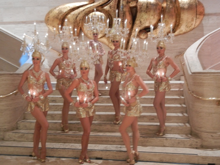 Chandeliers Dancers.  There is no better way to wow your guests, with Our beautiful Crystal Chandelier Dancers could appear anywhere in the room with lighted crystal Chandeliers on the top of their heads!