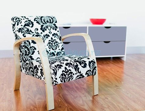 Cute chair for the lounge, but in orange and white paisley