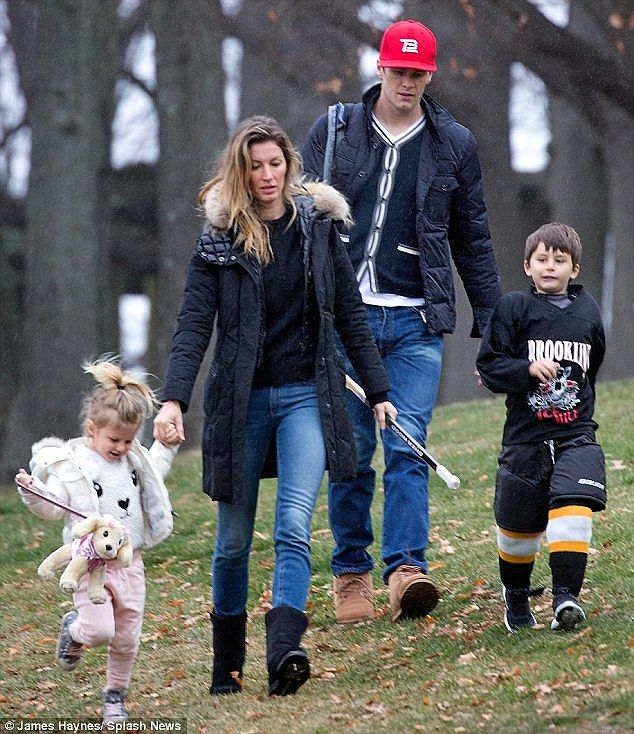 Family first: The model was spotted walking with her husband Tom Brady and their two children, Benjamin and Vivian, in Boston last month