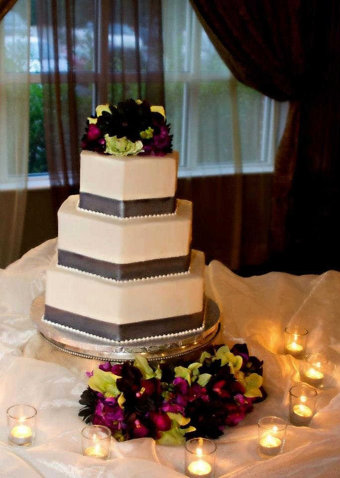 A Modern Silk Flower Wedding Cake Topper Created With Black Gerbera Daisies And Green Purple Cymbidium Orchids By It Tops The