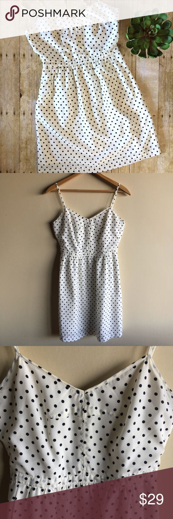 "J. Crew polka dot dress with pockets By J. Crew factory, off white and black polka dotted dress with adjustable straps. Lined. Side pockets. Measures 17"" from underarm to underarm, 13.5"" across waist and 35"" long. 100% silky feeling polyester. Excellent condition! ""Seaside Cami Dress"" J. Crew Factory Dresses"