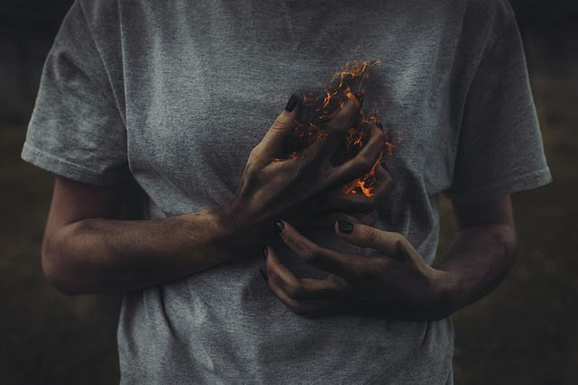 Sometimes, the fire in her is devouring her heart. It is an unpleasant feeling but her heart withstands the fire by rising from the ash like a phoenix.
