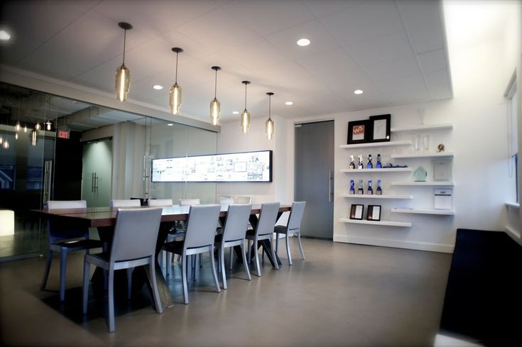 love something about this...lighting over the dining table  modern lighting | Pharos Modern Pendant Lights over a boardroom table