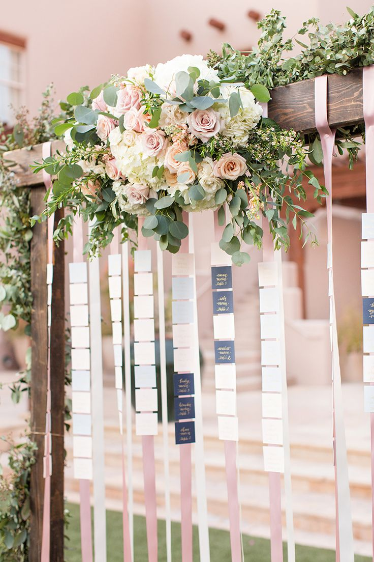 ribbon seating charts - photo by Amy and Jordan Photography http://ruffledblog.com/feminine-floral-wedding-in-the-arizona-desert