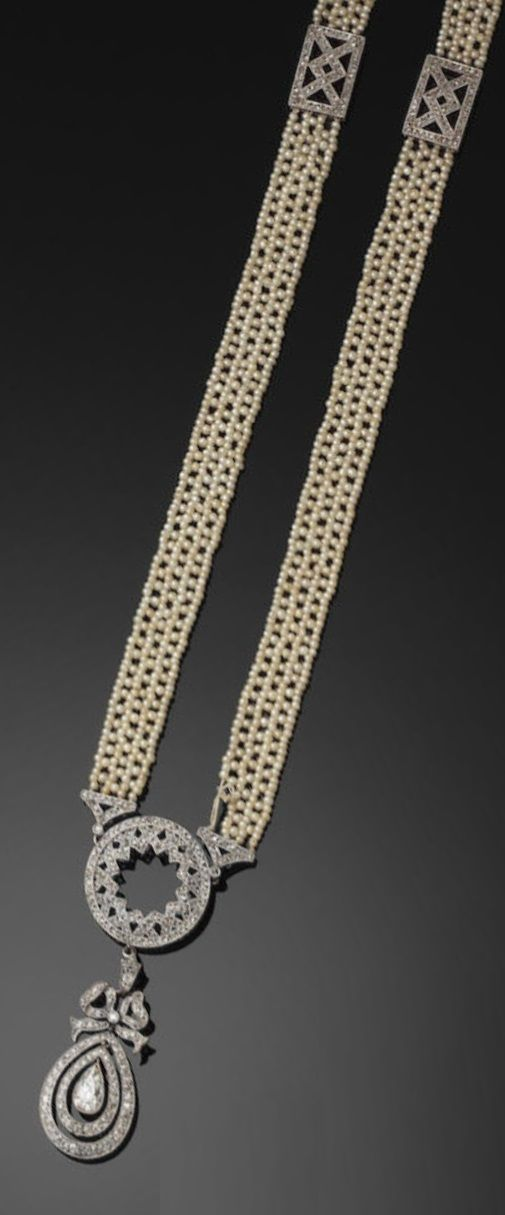 An elegant Belle Epoque diamond and seed-pearl sautior. Formed as a woven necklace of seed-pearls intercepted by two openwork rectangular panels of zig-zag design set with rose-cut diamonds and with a circular diamond-set link to the front suspending a pear-shaped pendant by means of a bow design top loop, the pendant with a pear-cut diamond to the centre of two diamond-set frames in original midnight-blue and gold tooled leather case with fitted powder blue interior by Carrington & Co.