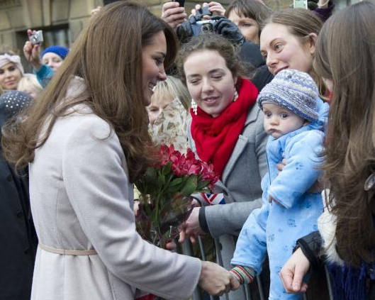 Catherine, Duchess of Cambridge meets 5 month-old James William Davies, who was named after Prince William, and his mother Tessa Davies in the Market Square