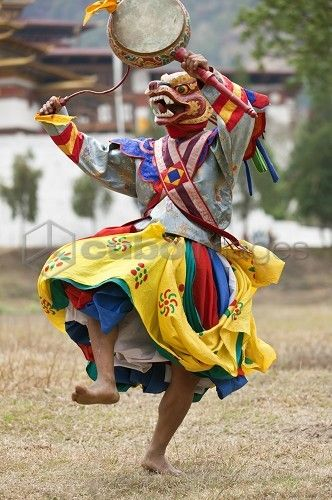 mask dancer in Chaam (a mysterious celemony in Buddah Festivals). the main colours of Bhutan culture are : red, blue, yellow, orangr, white. those are colours on Buddah Flag