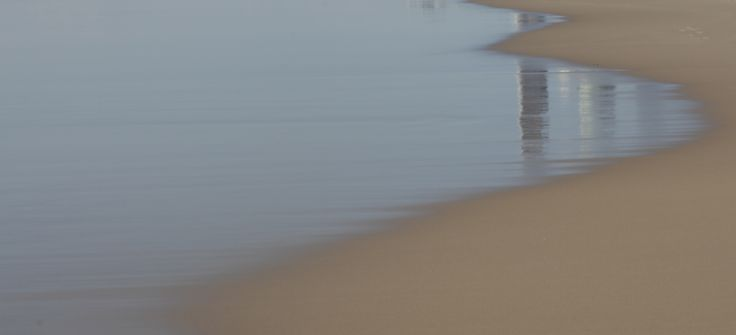 Sand, water, reflection - 50mm prime, f7, 1/50