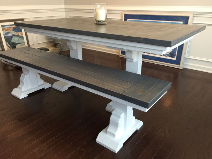 This farmhouse table and bench feature a vibrant white base with grey gel sta