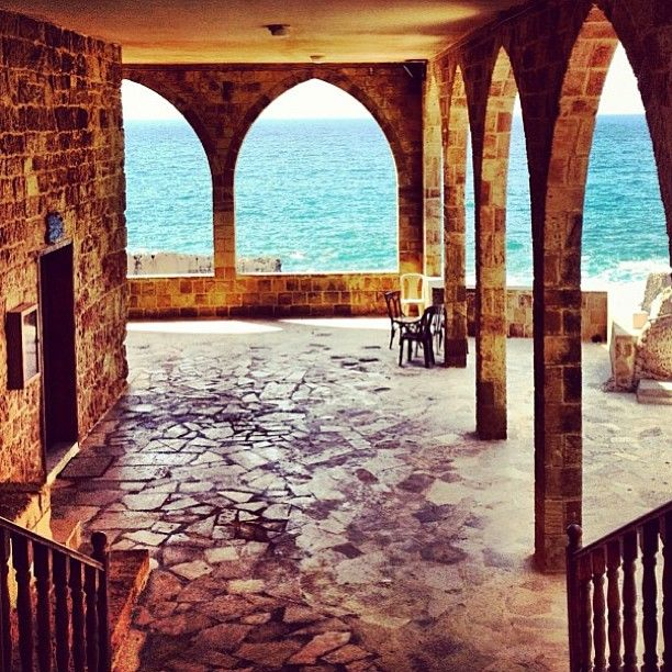 """Entrance to the  Church of """"Our Lady of the Seas"""" in front of the Phoenician Wall (225 meters length 6 meters height) , Batroun,  Batroun District, North Governoate, Lebanon"""