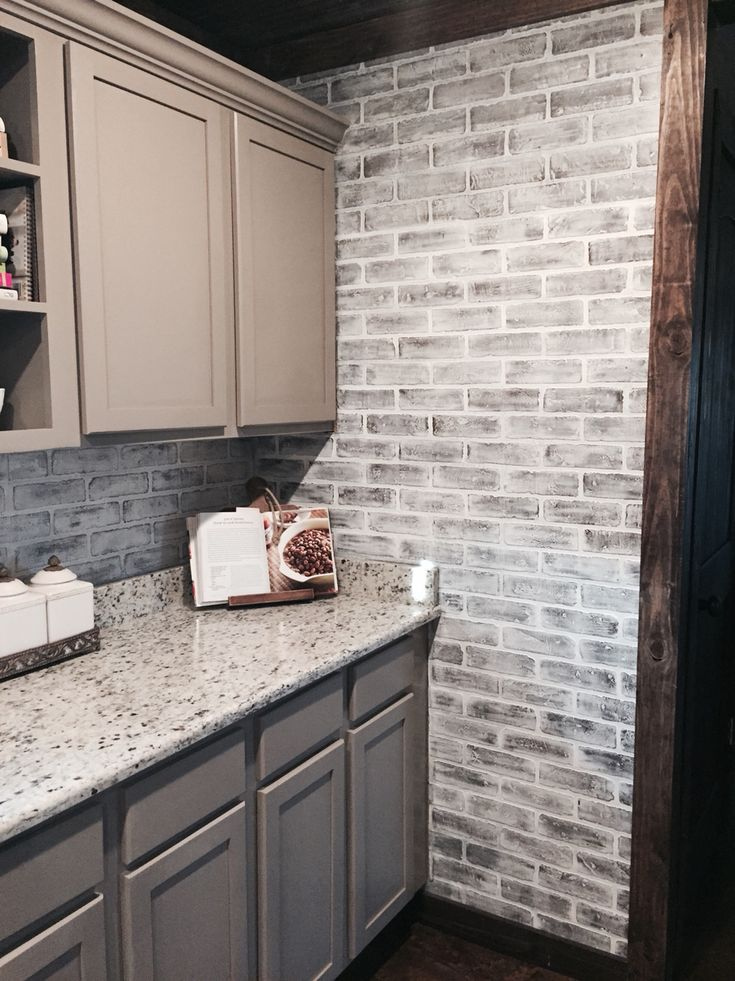 Lowes brick panels painted white. Brick backsplash. Paint color- studio  taupe by Behr