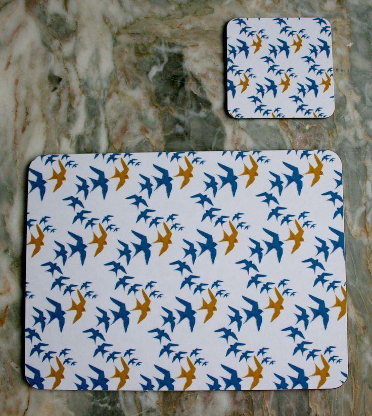 """""""Flock"""" Design Placemats (4 for £25) & Coasters (4 for £12). The ideal accessory to bring colour and pattern to your kitchen or dining table.  Made in England, this set of 4 heat resistant, melamine mats feature original The Humble Cut potato printed artwork.  Heat resistant to 145ºC, wipe clean with a cork back. #swallows #placemats #kitchenware"""