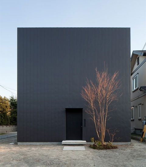 love the grey hue and the single warm tree in front of it. | japanese architecture featuring warm minimalism, on designhunter