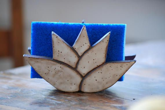 This listing is for one lotus flower sponge holder. This piece is slightly elevated with ceramic feet and has holes in the base to promote drainage and keep your sponge clean and dry. It measures approximately: 3 inches tall by 4 inches wide and 2 inches in depth. The color is