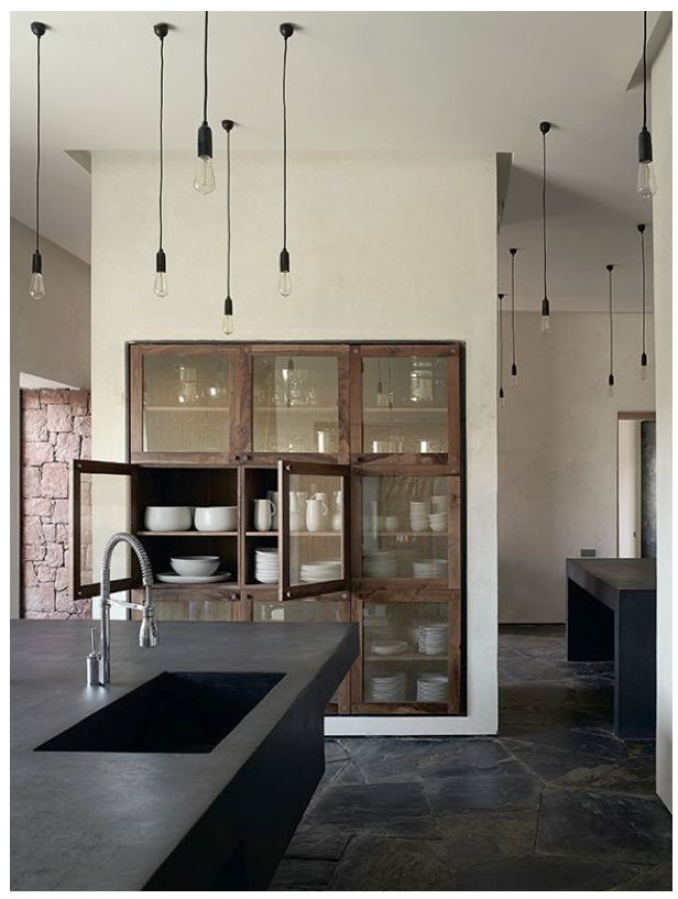 10 Rooms: Palette: Bone and Black | Kitchen Rustic stone flooring, wood glass doors on built-in cabinetry