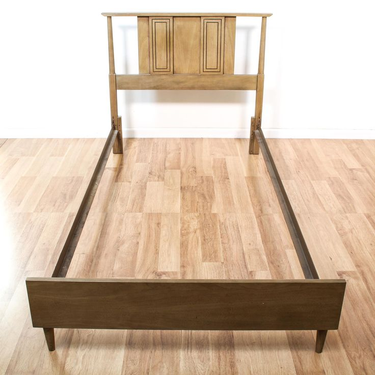 This bed frame is featured in a solid wood with a glossy beech finish. This mid century modern bed has a headboard w/ carved rectangular panels and footboard w/ tapered feet. Perfect for any bedroom! #midcenturymodern #beds #bedframe #sandiegovintage #vintagefurniture
