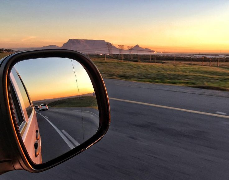 Photo by @manablazemick • side mirror shot · rear view · looking back · mountains · road trip · travel · black and white · South Africa · sunset · rural · photography · traffic · transport · landscapes · Cape Town · colors