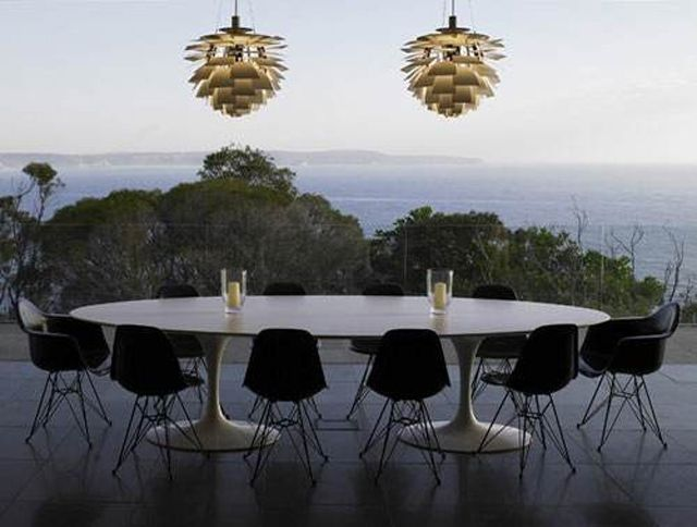 PH stands for Poul Henningsen. He designed the Artichoke Ceiling Lamp. Look at how this beautiful light fixture becomes the focal point in the room. Amazing! Get yours for a discount visit DesigndistrictModern.com.