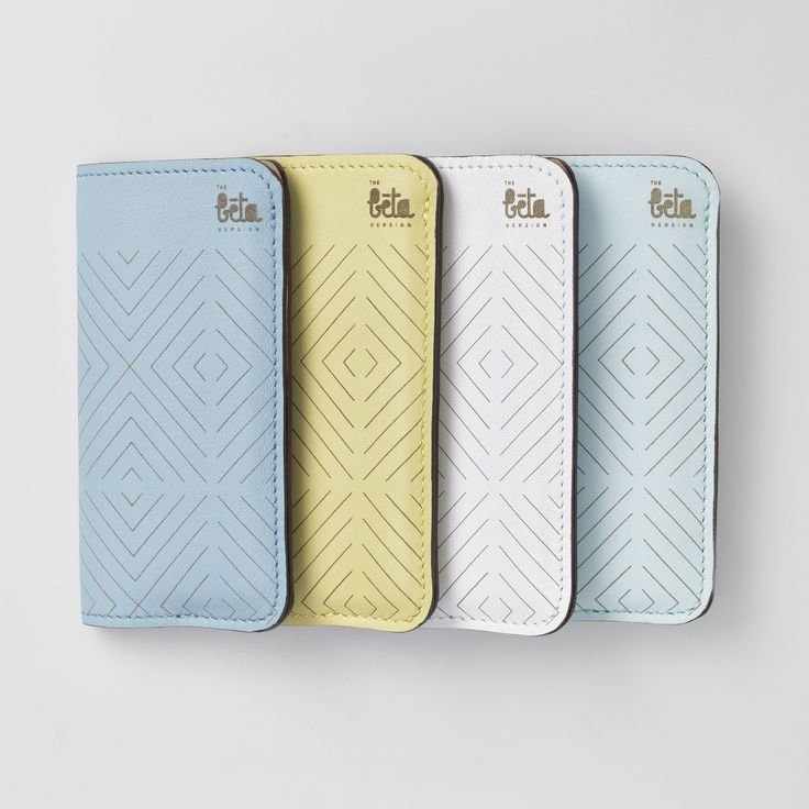 TheBétaVersion leather phone sleeves in light blue, pastel yellow, white and pastel blue. The sleeves have a credit card sized pocket on the back and come with laser engraved geometric pattern.