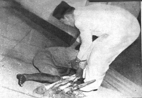 That pic shows an Indonesian fisherman bow and kiss Soekarno's feet (Soekarno, first president of Indonesia) even before Soekarno ask his purpose come to him. Yes, that what the fisherman's purpose. The fisherman promise that before he die, he wanted to see President's face and to show his love and loyalty to president as he never seen in television or newspaper. He is the first president of Indonesia who might never reborn his personality in the future.