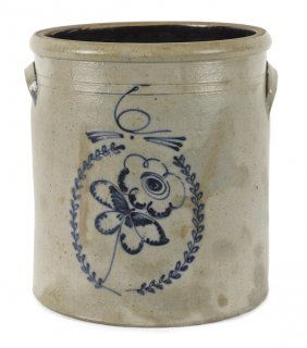Six-gallon stoneware crock, 19th c., with a cobalt  flower in wreath decoration