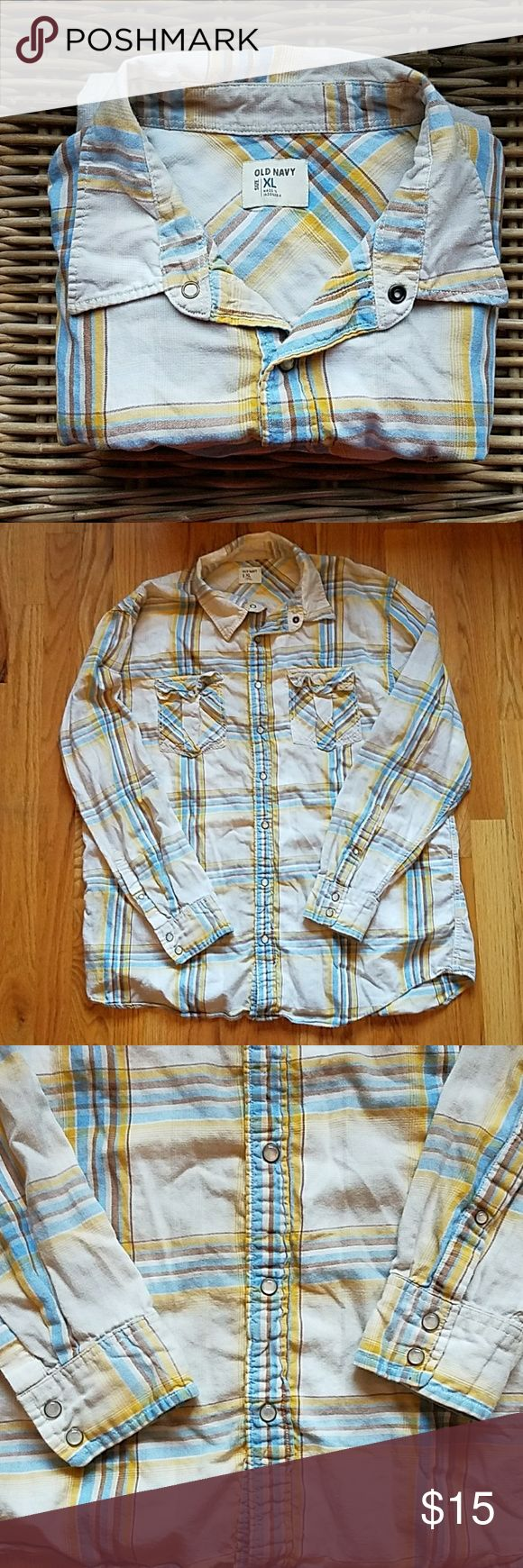 snap-button men's plaid shirt. - plaid shirt in cream, brown, blue, & yellow. - button down closure with snap buttons, as well as the buttons along the edge of the sleeve cuffs (see 3rd photo). - small functioning pockets on either side of the chest.  - will accept any reasonable offers! Old Navy Shirts Casual Button Down Shirts