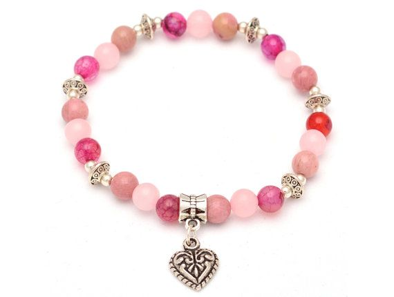 Our custom-designed Intention Bracelet is made of 6mm Rose Quartz, Rhodocrosite and Pink Tourmaline Natural Stone Beads on latex free elastic cord. This stretch bracelet is finished with a Heart Charm and Sterling Silver and Tibetan Silver findings. Comes in a gift box.    Rose Quartz Properties:  • Attracts love  • The stone of unconditional love  • Master Healer for the heart and emotions    Rhodocrosite Properties:  • Excellent for the heart and relationships  • Helps attract your…