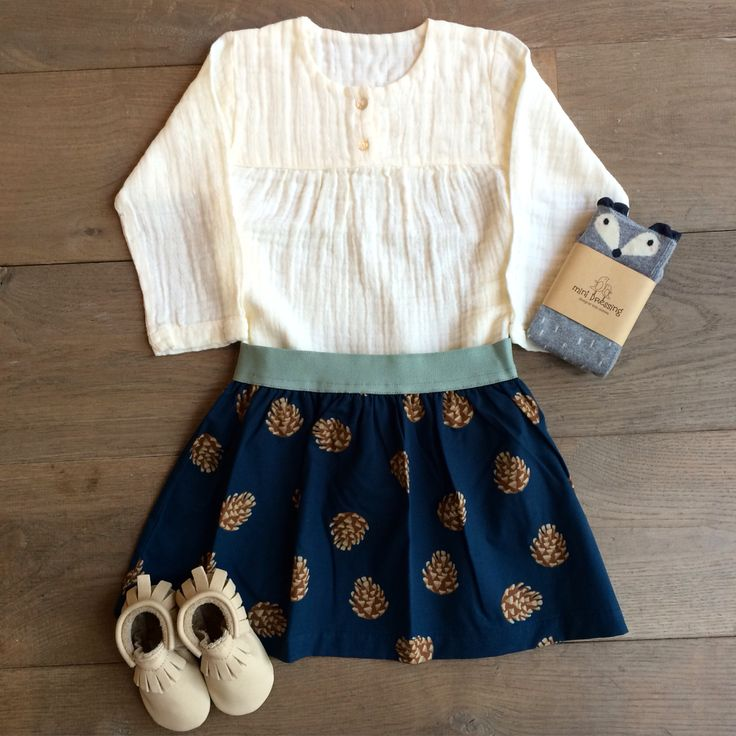 If Autumn was a skirt, this pine cone one would be it!   Poudre Organic Blouse £26.50 Tinycottons skirt £27.50 Mini Dressing Socks £9 Amy & Ivor handmade shoes £38