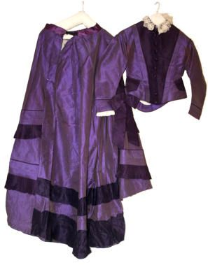 This mauve dress with jacket is a rare and important survivor from the early 1860s.In 1856, the chemist, William Henry Perkin, then 18, discovered the purple dyestuff which soon became known as Perkin's mauve, mauveine, aniline purple.Perkin treated phenylamine (or aniline) with potassium dichromate. An unpromising black solid resulted. Perkin dissolved the solid in aqueous ethanol, whereupon a beautiful purple solution formed.