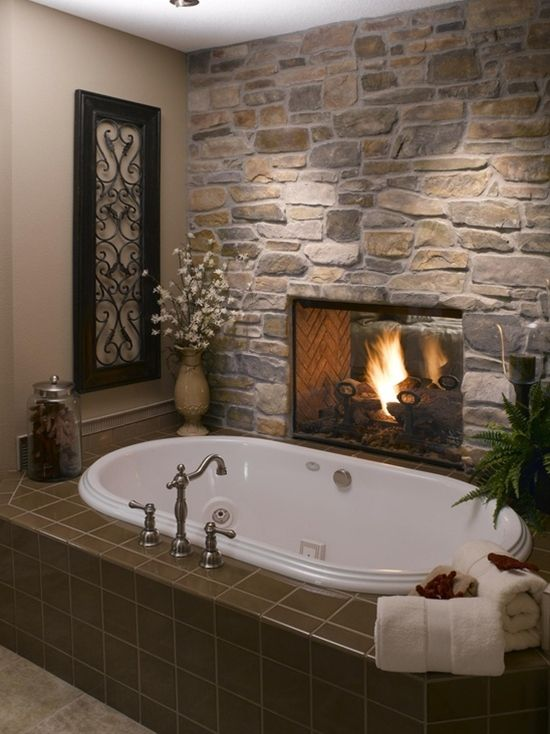 Fireplace between the master bedroom and tub. love love love