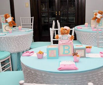 We love the play on words (and ease of creation!) with this baby shower 'Building our Family Blocks' centerpiece idea. With or without the added teddy bears, the idea is adorable.