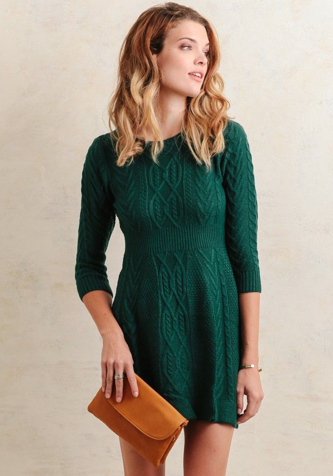 This cozy sweater dress is crafted in a gorgeous dark-teal hue and features a variety of cable knit patterns for a unique look. Designed with a ribbed waistline and ribbed hems, this cold-weath...