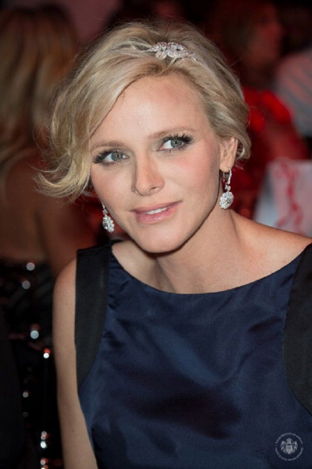 Princess Charlene of Monaco the blonde beauty accessorized with a pair of diamond drop earrings and a diamond hair clip as she attends the 66th Monaco Red Cross Ball Gala 2014 at 'Summer Sporting' in Monte-Carlo, Monaco in Aug 1st.