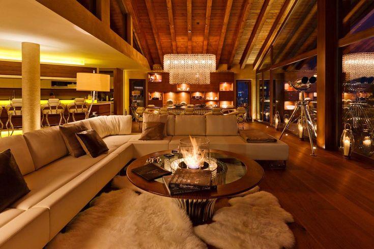 Chalet Zermatt Peak Zermatt living room with sofas at night