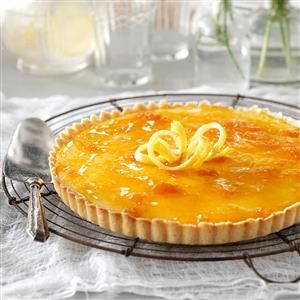 French Lemon-Apricot Tart Recipe -If you like the tang of citrus, you'll love this lemon tart. The apricot preserves on top add a nice bit of sweetness. —Peggy Lunde, Costa Mesa, California