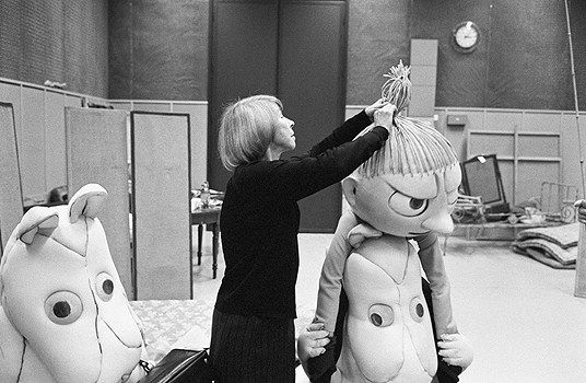 Tove Jansson finishing touches to some giant moomins skin characters