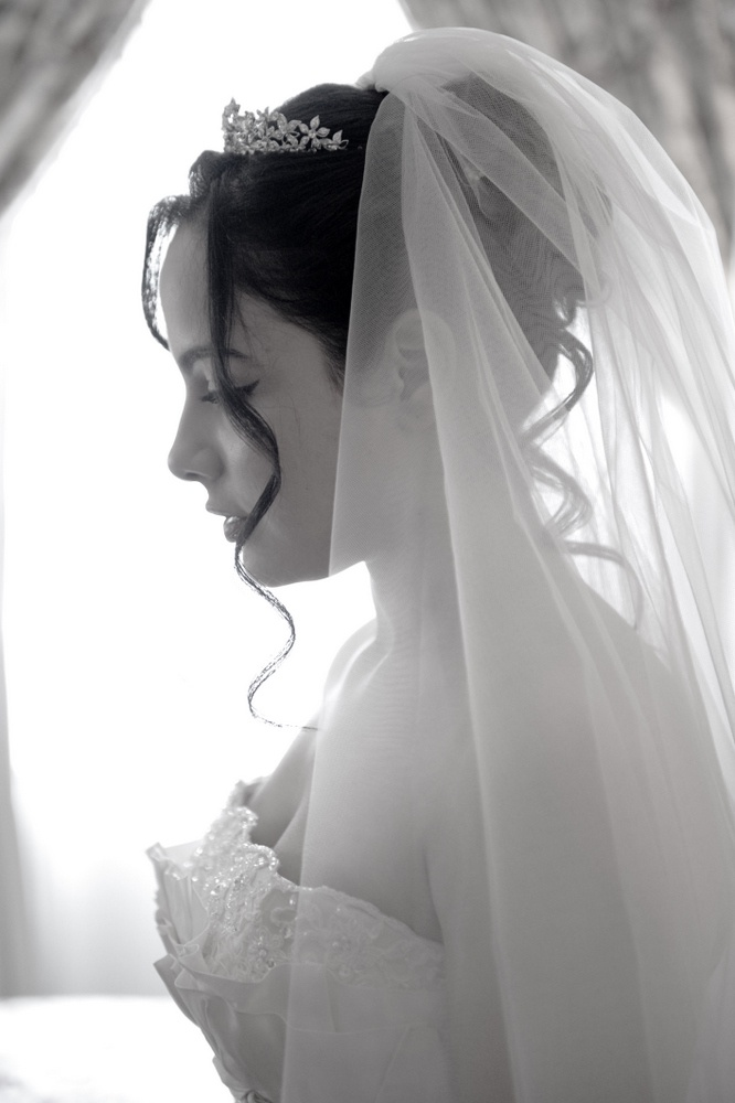 up do with high veil and crown
