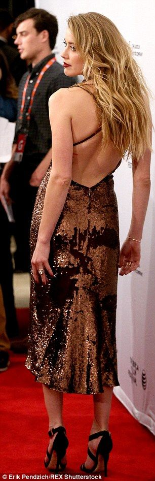 Oozing glamour: Amber Heart turned up the heat in a shimmery dress at the premiere of When...