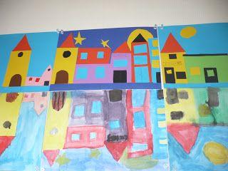 Huizen plakken daarna de weerspiegeling schilderen. Leuk!