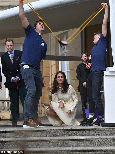 The Duchess pulled back a large sling, where the duo had filled with a water balloon...