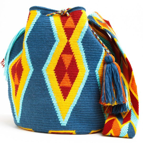 WAYUU TRIBE | #Handmade Bohemian Bags made by the indigenous Wayuu Tribe in Colombia!  #Bags starting at $98.00 - $225.00 We offer international shipping including Brazil.  #Mochila #Bolsa #Yoga #Crochet #Knit #yarn #moda #mode #boho #handbag #streetstyle